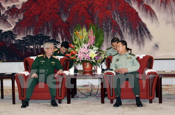 Senior military officials of Vietnam, China meet in Beijing hinh anh 1