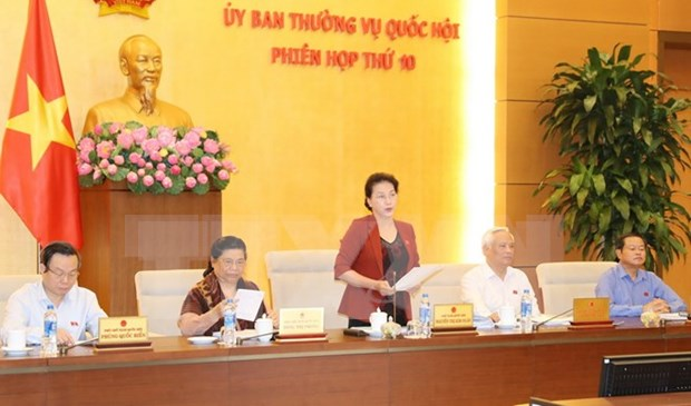 NA Standing Committee wraps up 10th session hinh anh 1
