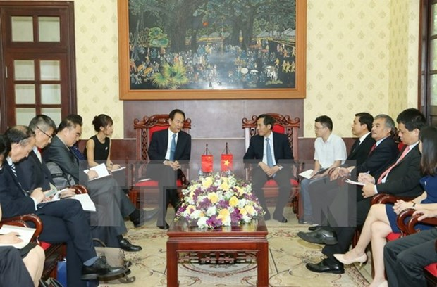 Xinhua President visits Nhan Dan newspaper hinh anh 1