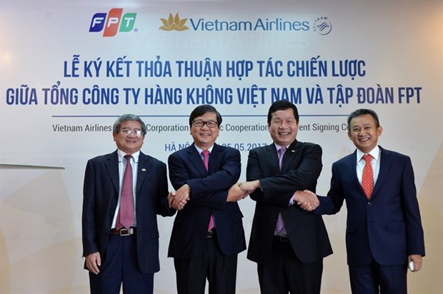 Vietnam Airlines, FPT sign cooperation agreement hinh anh 1