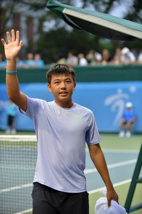 Nam through to Singapore tennis event's second round hinh anh 1