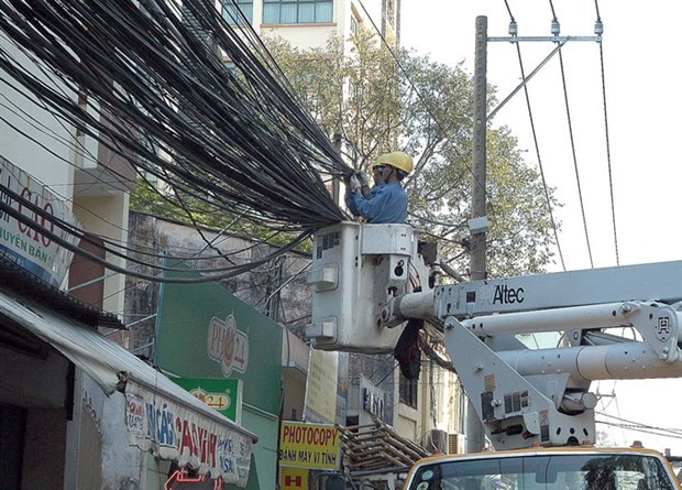 Electric power lines going underground in HCM City hinh anh 1