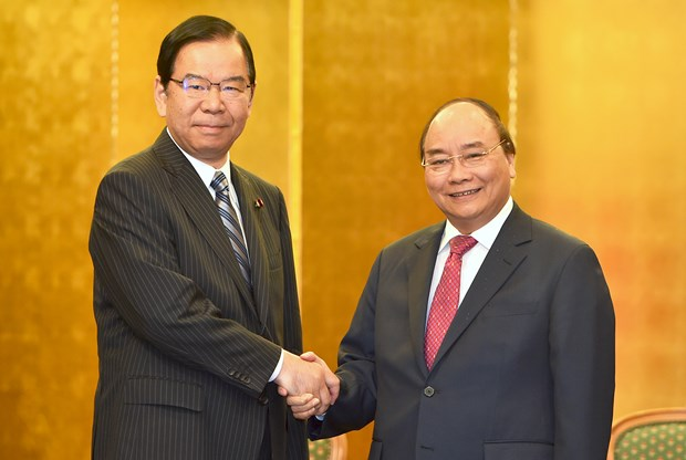 Prime Minister meets Japanese party, local leaders hinh anh 1