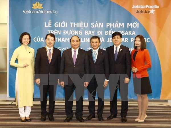 PM attends debut ceremony for flights to and from Osaka hinh anh 1