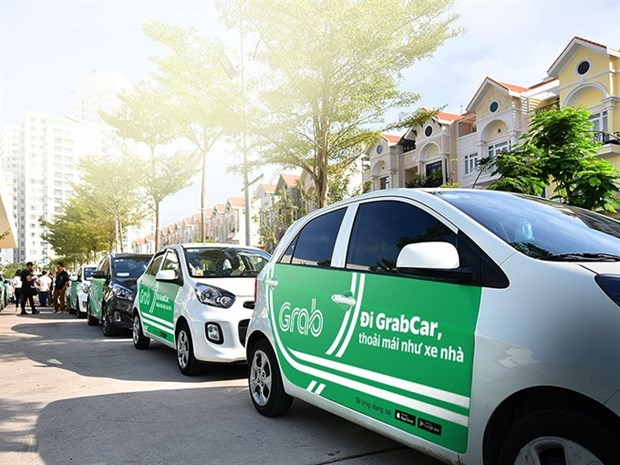 Drivers hurt in Grab, Uber, taxi price war hinh anh 1