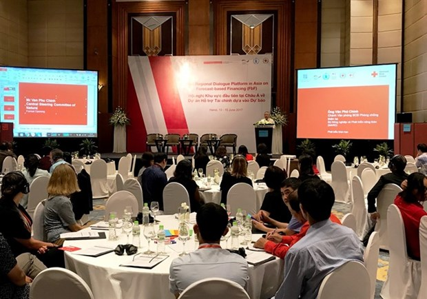 Conference on forecast-based financing opens in Hanoi hinh anh 1
