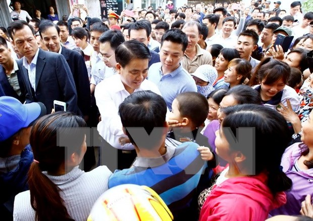 Criminal proceedings launched against illegal arrest of people in Hanoi hinh anh 1