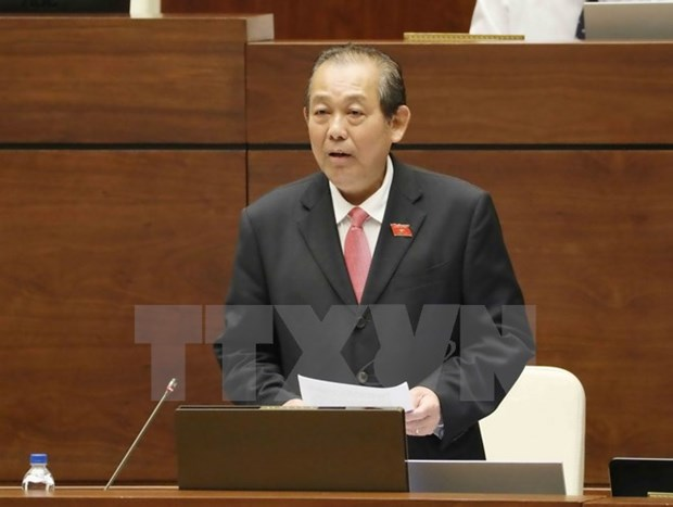 Deputy Prime Minister takes floor at NA's Q&A session hinh anh 1