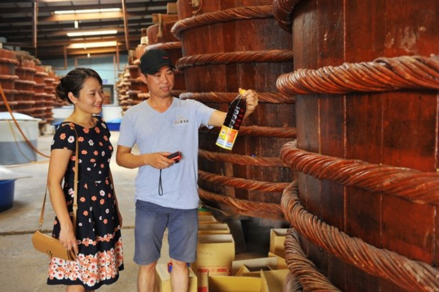 Vietnamese firms urged to boost branding hinh anh 1