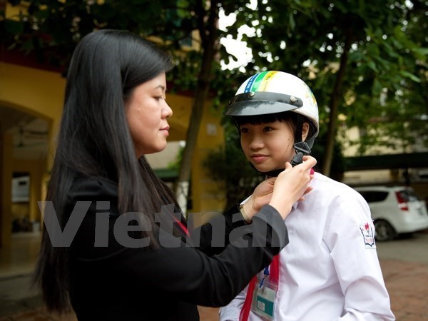 Dong Nai: 79 percent of children wear helmets hinh anh 1
