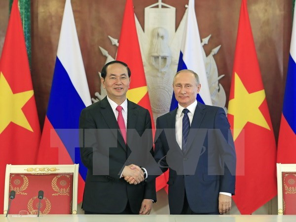 President's visits lift up Vietnam's partnership with Russia, Belarus hinh anh 1