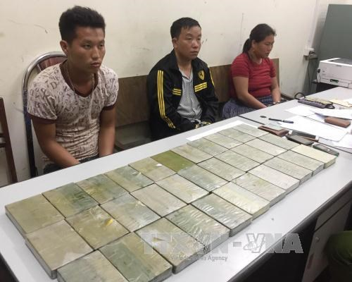 Five drug traffickers, 40 bricks of heroin seized in Son La hinh anh 1