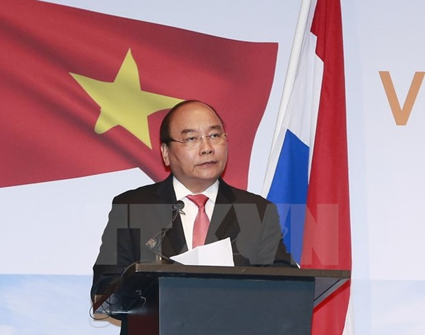 Vietnam to lift restrictions on foreign investors: PM hinh anh 1