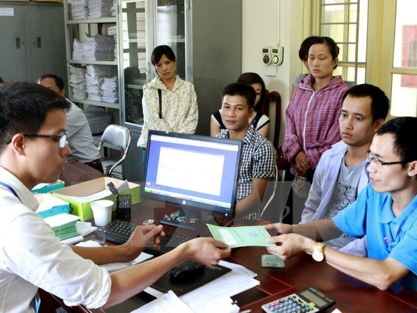 13.3 million social insurance books granted in first half hinh anh 1