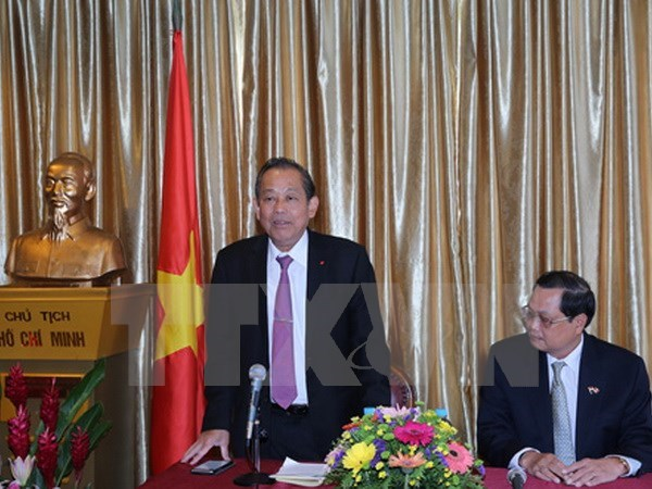 Deputy PM hails role of Vietnamese community in Singapore hinh anh 1