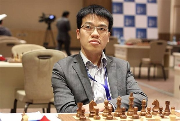 Le Quang Liem wins over world's chess champion hinh anh 1
