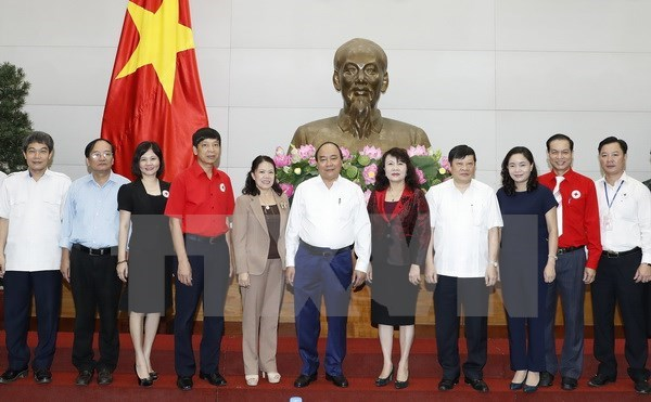 Vietnam Red Cross asked to continue ensuring social welfare hinh anh 1
