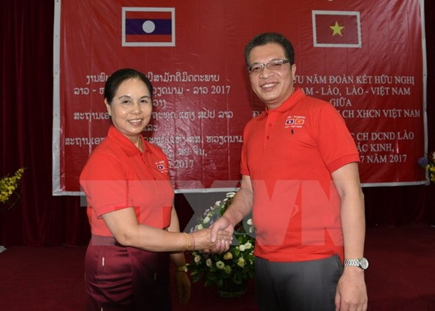 Vietnam, Laos celebrate 55th year of diplomatic ties in China hinh anh 1