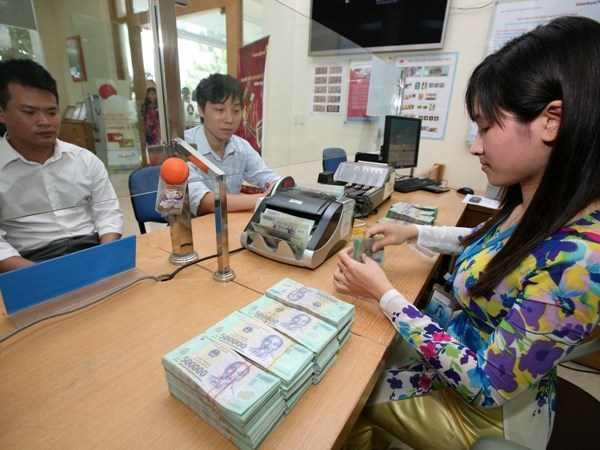 Reference exchange rate down 1 VND hinh anh 1