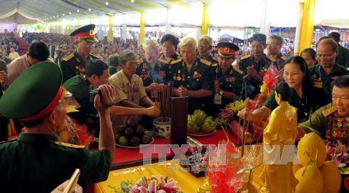 Exhibition highlights efforts to care for national contributors hinh anh 1