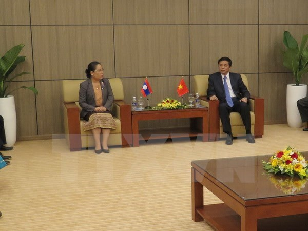 NA Offices of Vietnam, Laos tighten ties hinh anh 1