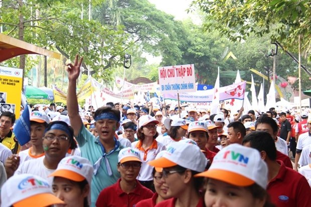 Over 5,000 people to walk for AO victims, disabled people hinh anh 1