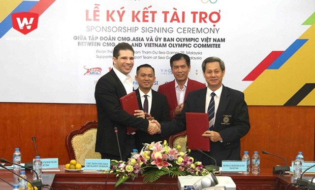 CMG.ASIA sponsors VN sport delegation at 29th SEA Games hinh anh 1