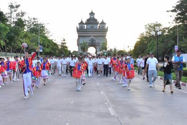 Laos holds mini-marathon to celebrate 50th ASEAN anniversary hinh anh 1