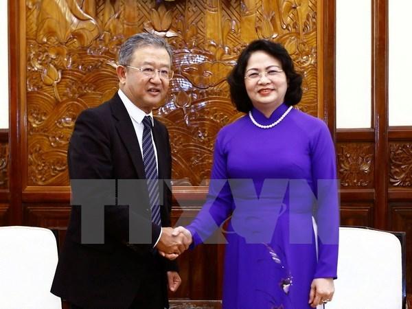 Vice President Dang Thi Ngoc Thinh meets AIA Chief Executive hinh anh 1