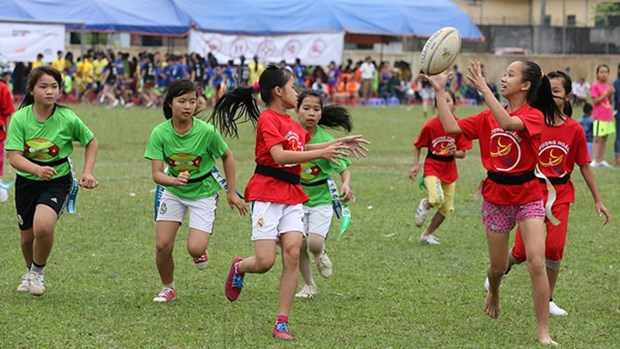 Vietnamese children equipped with life skills through rugby hinh anh 1