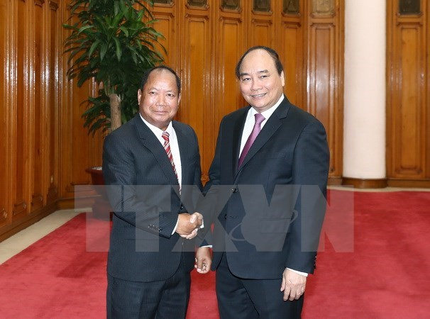 PM calls for stronger security ties with Laos hinh anh 1