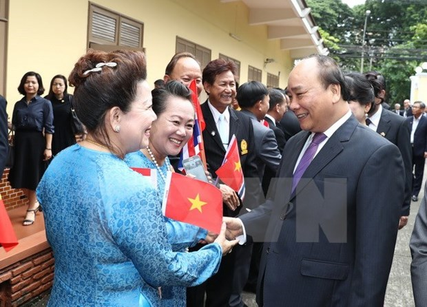 PM lauds friendship role of Vietnamese community in Thailand hinh anh 1