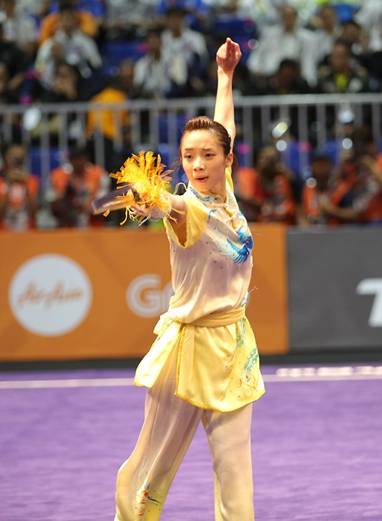 SEA Games 29: Wushu artists bring home first two golds hinh anh 1