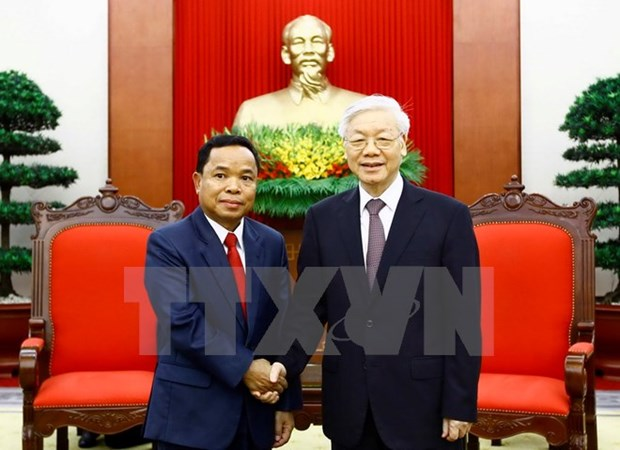 Vietnamese Party leader receives Lao Party office chief hinh anh 1