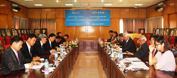 Vietnam, Laos peace committees enjoy fruitful cooperation hinh anh 1