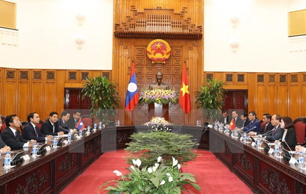 PM: Vietnam, Laos need to enhance inspection cooperation hinh anh 1