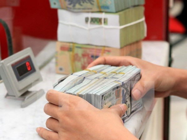 Reference exchange rate down 3 VND at week's beginning hinh anh 1