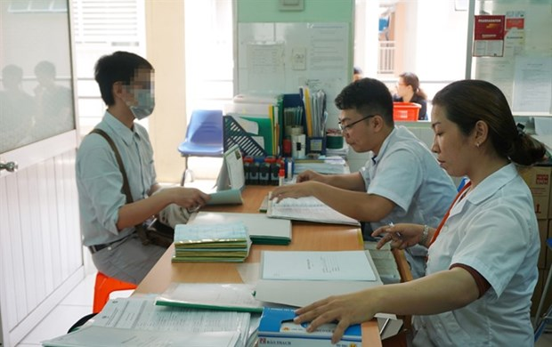 Health centre mergers require job reshuffle hinh anh 1