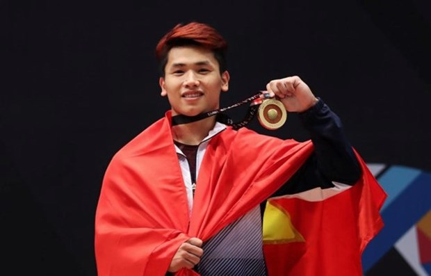 SEA Games 29: weightlifter Vinh wins gold, breaks 2 records hinh anh 1