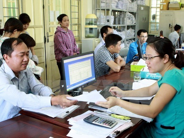 Hanoi publicises 500 firms with prolonged insurance debts hinh anh 1
