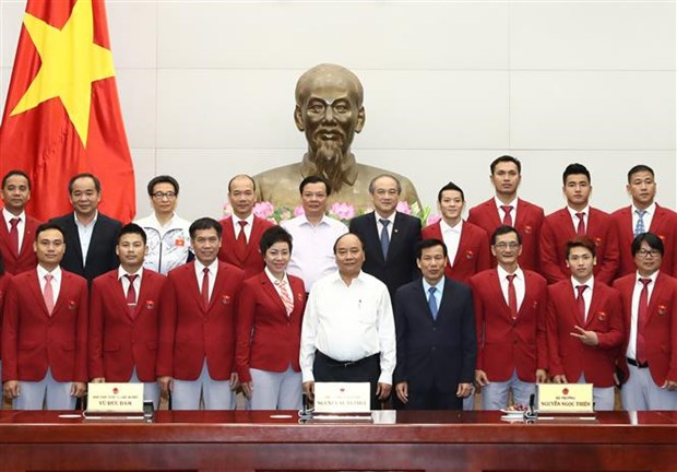 PM congratulates trainers, athletes on SEA Games achievements hinh anh 1