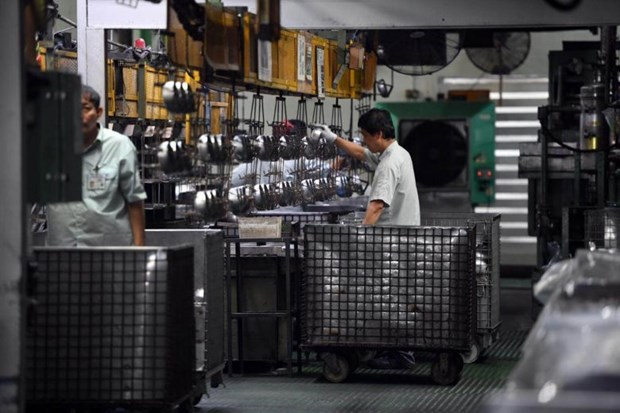 Singapore's PMI hits 33-month high hinh anh 1