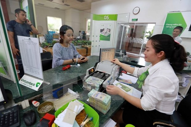 Reference exchange rate down by 15 VND hinh anh 1