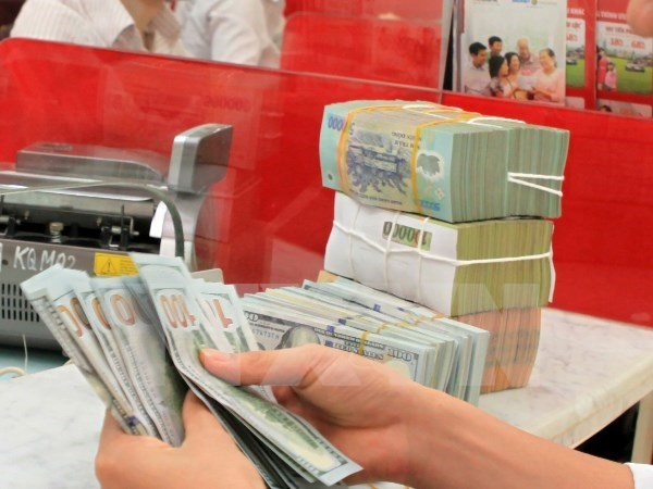 Reference exchange rate down by at 4 VND at week's beginning hinh anh 1