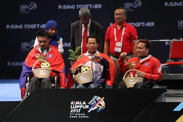 ASEAN Para Games: VN weightlifters win 2 gold, break 2 records hinh anh 1