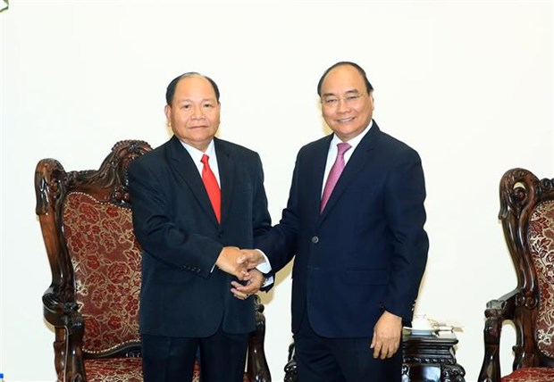 PM lauds Vietnam- Laos cooperation in home affairs hinh anh 1