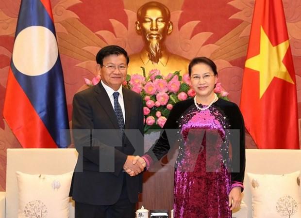 NA Chairwoman Nguyen Thi Kim Ngan welcomes Lao PM hinh anh 1