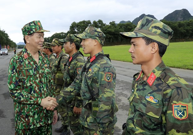 Army must keep improving itself to deserve people's trust: President hinh anh 1