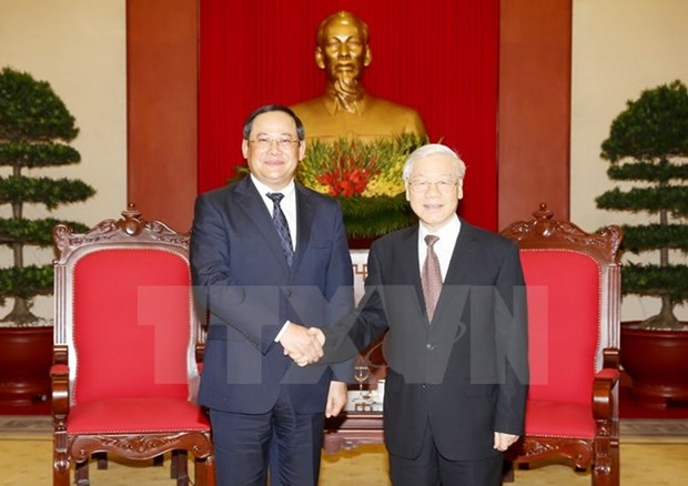 CPV General Secretary hosts Lao Deputy Prime Minister hinh anh 1