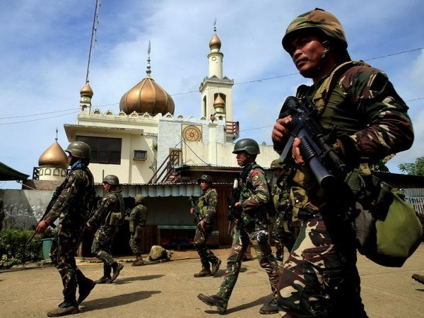Philippine police arrest Indonesian militant in Marawi hinh anh 1